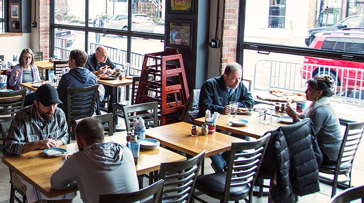 Customers dining at local pizzeria