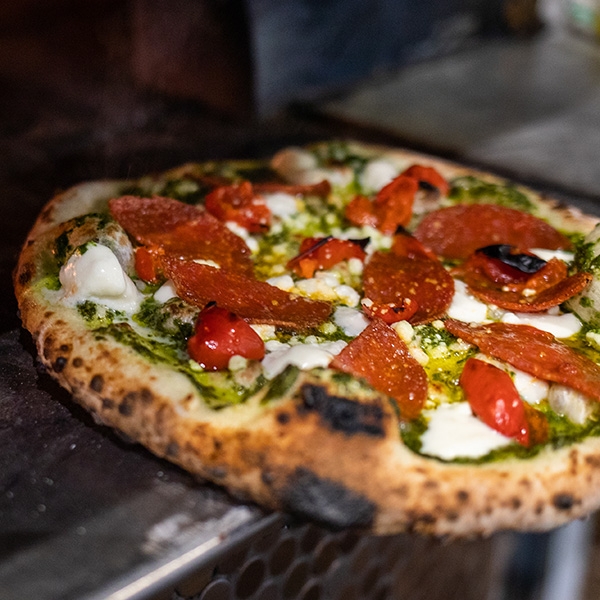 Neapolitan style pizza featuring Grande fresh mozzarella cheese coming out of the the oven